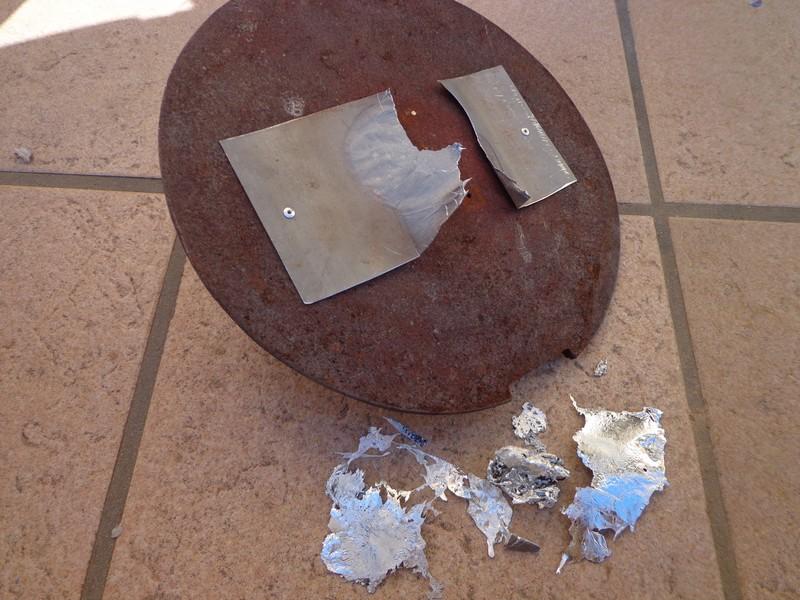 plaque de zinc fondue sous la plaque de chauffe